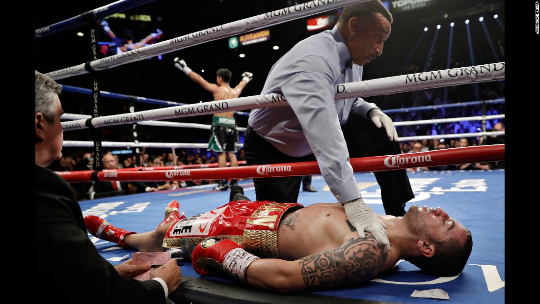 Dejan Zlaticanin lies on the mat after he was knocked out by Mikey Garcia in their lightweight title bout on Saturday, January 28. Both boxers came into the fight undefeated.