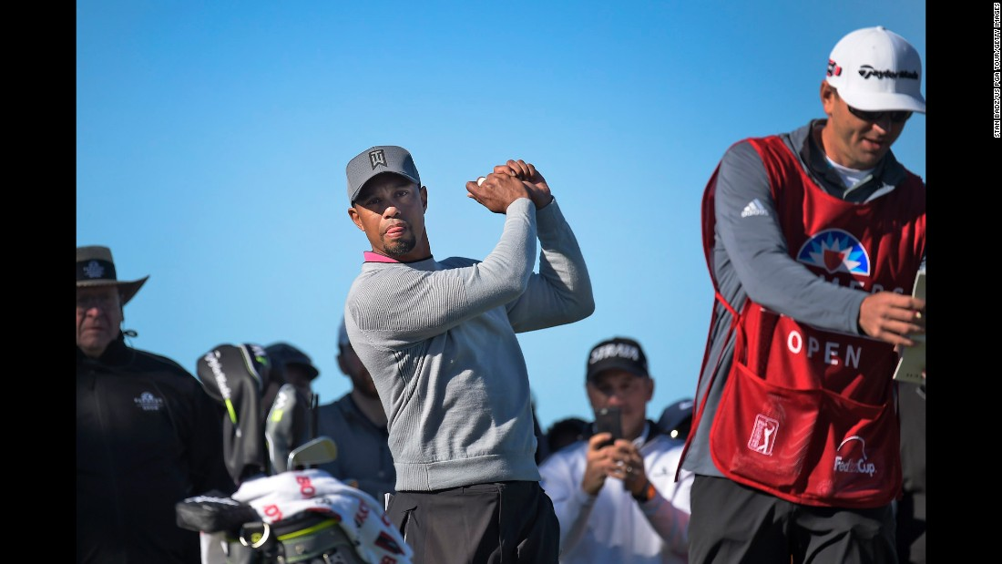 "Tiger Woods takes a practice swing during the second round of the Farmers Insurance Open on Friday, January 27. Woods <a href=""http://www.cnn.com/2017/01/27/sport/tiger-woods-torrey-pines-pga-tour-comeback-2017/"" target=""_blank"">missed the cut</a> as he works his way back from a long injury layoff."