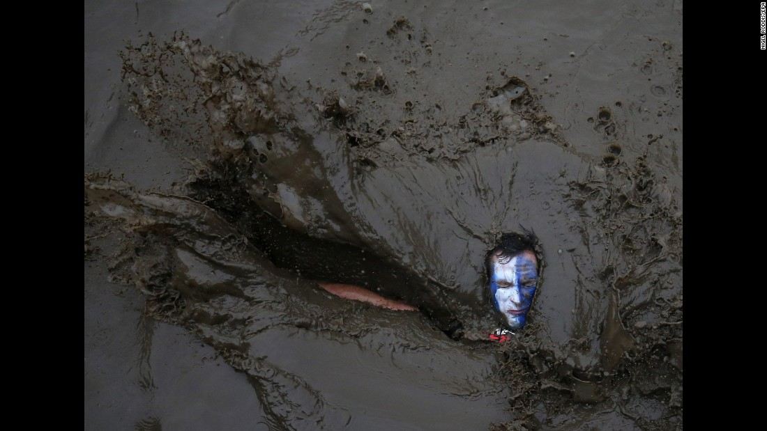 A competitor falls in mud during a Tough Guy event in Perton, England, on Sunday, January 29. The annual charity race includes a cross-country run and various obstacles.