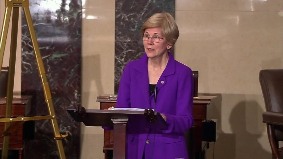 warren tears up immigration ban sot _00003726.jpg