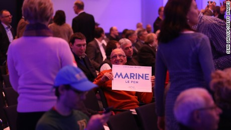 A man holds a Marine Le Pen placard at a conference of European populist, right-wing parties in Koblenz, Germany.