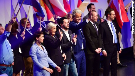 Le Pen stands on stage with other far-right European politicians at an event hosted by the Europe of Nations and Freedom political group.