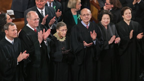 WASHINGTON, DC - FEBRUARY 12: Members of the Supreme Court, (L-R) Chief Justice John Roberts and associate justices Anthony Kennendy, Ruth Bader Ginsburg, John Paul Stevens, Sonia Sotomayor and Elena Kagan, applaud as U.S. President Barack Obama arrives to deliver his State of the Union speech before a joint session of Congress at the U.S. Capitol February 12, 2013 in Washington, DC. Facing a divided Congress, Obama focused his speech on new initiatives designed to stimulate the U.S. economy and said,