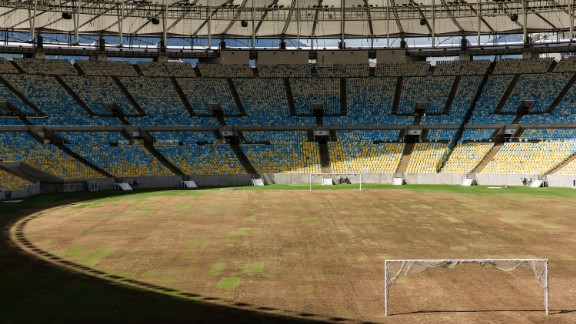 The pitch of the Maracana stadium in Rio de Janeiro, where its turf is dry and worn. The iconic stadium hosted the 2016 Olympic Games, but six months later a series of legal battles and abandonment have left this once glorious venue in a state of total decay. Photographer Joao Pina explored the stadium on assignment for CNN.