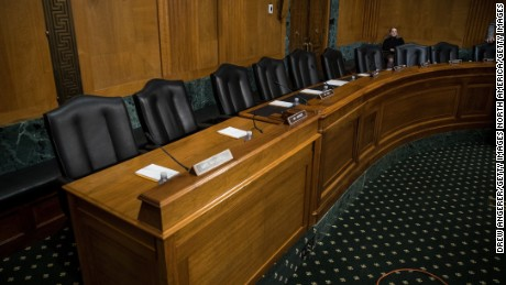 A view of empty Democrat seats during a meeting of the Senate Finance Committee to vote on the nominations of Cabinet nominees Tom Price and Steve Mnuchin on Wednesday. After Senate Democrats on the committee did not show up for the meeting for the second day in a row, Senate Republicans on the committee suspended committee rules and voted on Price and Mnuchin without the Democrats.