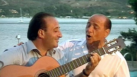 Berlusconi sings with Italian performer Mariano Apicella during a party in 2003.