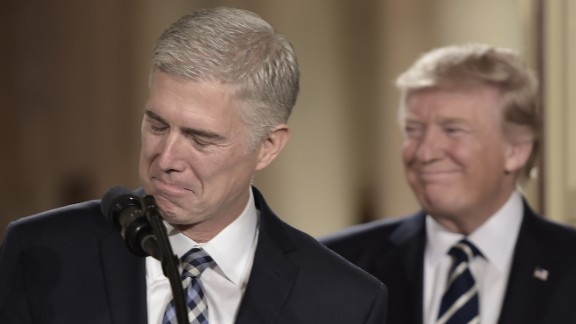 Judge Neil Gorsuch (L) speaks, after US President Donald Trump nominated him for the Supreme Court, at the White House in Washington, DC, on January 31, 2017.