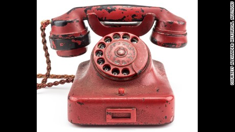 Hitler's phone, which was originally black, was painted red and engraved with his name and a swastika.