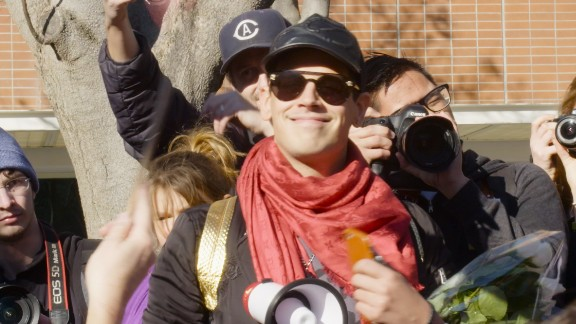 """Milo Yiannopoulos leads a march on the UC Davis campus after his speaking event was canceled due to """"security concerns."""""""