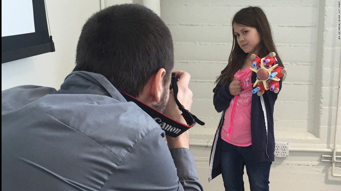 Jordan shows off her glitter-shooting prosthetic arm she made a the Superhero Cyborg camp in January 2016.