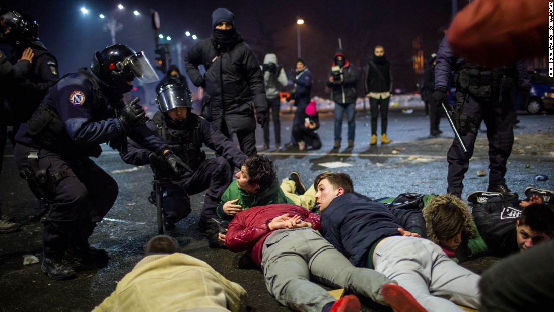 Police detain demonstrators February 1 in Bucharest.