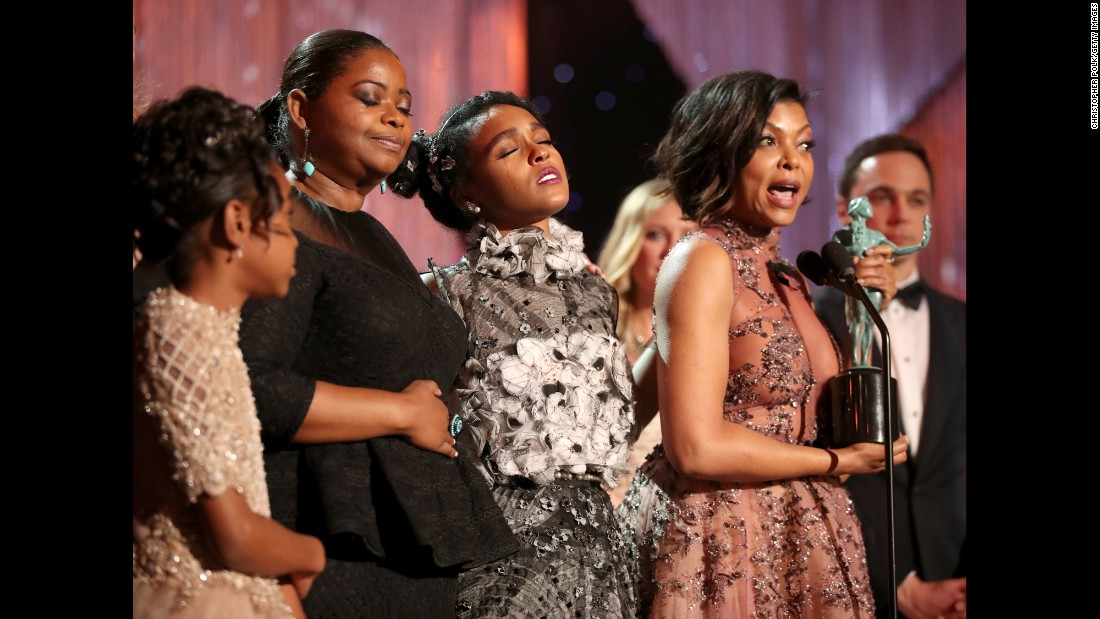 """Hidden Figures"" stars Octavia Spencer, second from left, Janelle Monae and Taraji P. Henson accept an award at the SAG Awards in Los Angeles on Sunday, January 29. ""Hidden Figures"" -- based on the true story of African- American women who played vital roles in NASA's early space missions -- won for outstanding performance by a cast in a motion picture. ""This film is about unity,"" Henson said while accepting the award."
