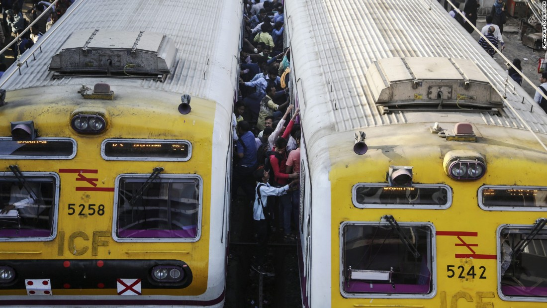 Commuters board a train in Mumbai, India, on Wednesday, February 1.
