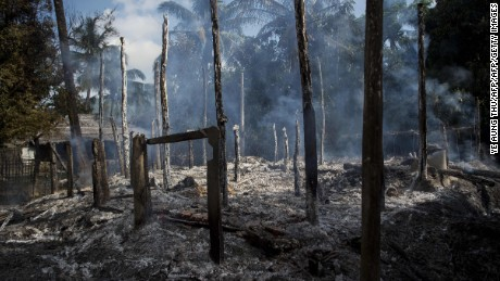 Smouldering debris of burned houses is seen in a village in Myanmar's Rakhine state.