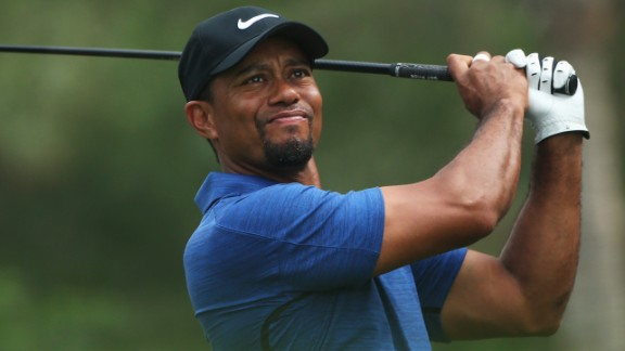 """A """"back spasm"""" has forced Tiger Woods to withdraw from the Dubai Desert Classic."""