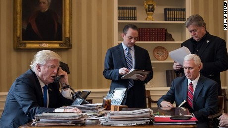 WASHINGTON, DC - JANUARY 28: President Donald Trump speaks on the phone with Russian President Vladimir Putin in the Oval Office of the White House, January 28, 2017 in Washington, DC. Also pictured, from left, White House Chief of Staff Reince Priebus, Vice President Mike Pence, and White House Chief Strategist Steve Bannon. On Saturday, President Trump is making several phone calls with world leaders from Japan, Germany, Russia, France and Australia.