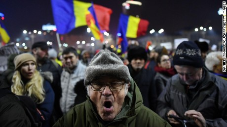 Protesters waved Romanian flags on Thursday in Bucharest.