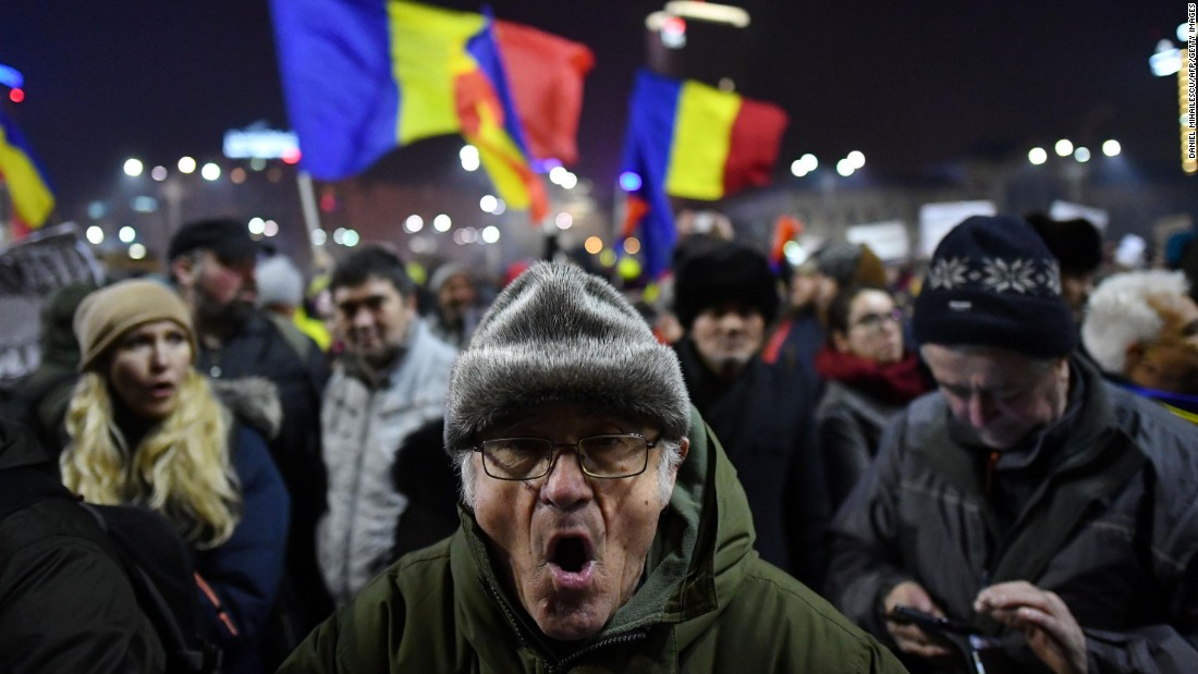 Romanians demonstrate in Bucharest on Thursday, February 2, after the government weakened penalties for corruption. Thursday marked the third night of anti-government protests in the Romanian capital.