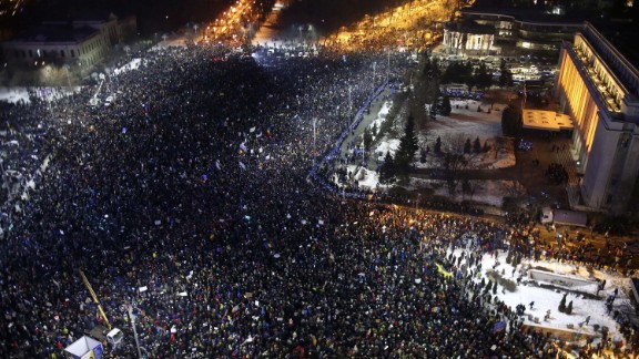 Protesters crowded in front of government headquarters in Bucharest on February 1,  demonstrating against the passage of a law that would decriminalize corruption.