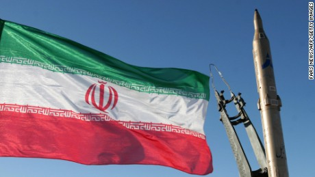 An Iranian flag flutters next to a ground-to-ground Sajil missile before being launched at an undisclosed location in Iran on November 12, 2008. Iran test fired today a new generation of ground-to-ground missile, the semi-official Fars news agency quoted the defence minister as saying. In the past Iran has often boasted of developing new weapons systems only to be met with scepticism from Western defence analysts. AFP PHOTO/FARS NEWS/STR (Photo credit should read -/AFP/Getty Images)