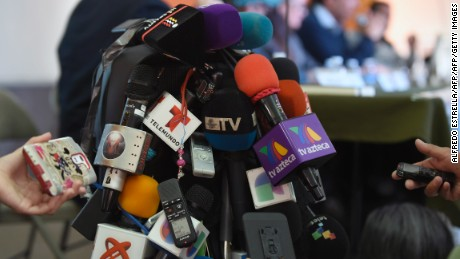 A heap of microphones and recorders from journalists during a press conference given by relatives of the 43 missing students of Ayotzinapa and members of the Argentine Team of Forensic Anthropology (EAAF) in Mexico City on February 9, 2016 about the human remains found in the rubbish dump of the Cocula community in Guerrero. The EAAF discarded the hypothesis that the 43 students could have been murdered and burned in that place, as the official version said. AFP PHOTO/ALFREDO ESTRELLA / AFP / ALFREDO ESTRELLA        (Photo credit should read ALFREDO ESTRELLA/AFP/Getty Images)