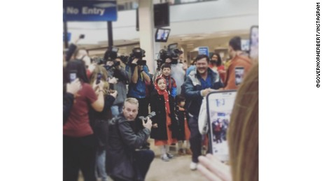 "Utah Gov. Gary Herbert posted this image on Instagram with the caption: ""A great Utah moment as we welcome Utah's newest pioneers, a family of Pakistani #refugees. #utpol"""