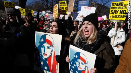 Martha Obermiller of Denver, right, chants during a rally protesting the immigration policies of President Donald Trump, near the White House in Washington, Saturday, Feb. 4, 2017. (AP Photo/Manuel Balce Ceneta)