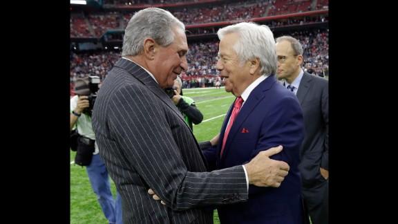 Atlanta owner Arthur Blank, left, greets New England owner Robert Kraft before the game.