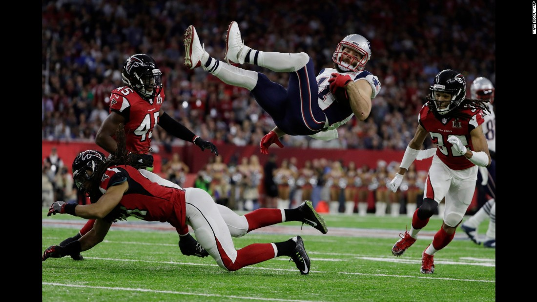 Edelman is upended by Atlanta's Philip Wheeler in the first quarter.