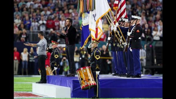 Country singer Luke Bryan sings the national anthem.