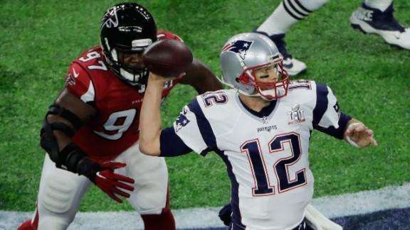 Brady is pressured by Jarrett, who got one of Atlanta