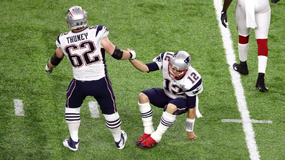 Brady is helped up by one of his linemen, Joe Thuney.