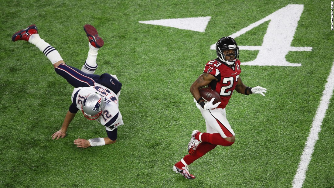 Brady tries to tackle Atlanta's Robert Alford, who intercepted Brady and ran it back for an 82-yard touchdown in the second quarter. Alford's score gave the Falcons a 20-0 lead. They led 21-3 at the half.
