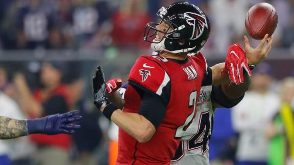 Atlanta quarterback Matt Ryan fumbles as he