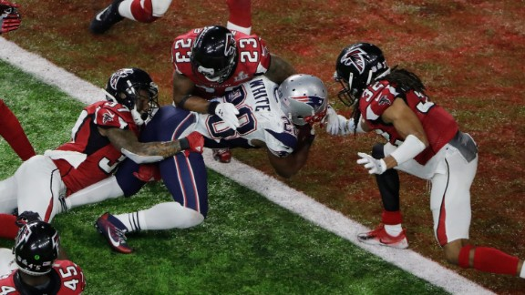 White scores the winning touchdown in overtime. It was the first time that the Super Bowl went to overtime.