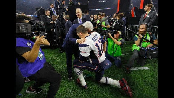 Brady celebrates with Patriots owner Robert Kraft after the game. Brady was named the game