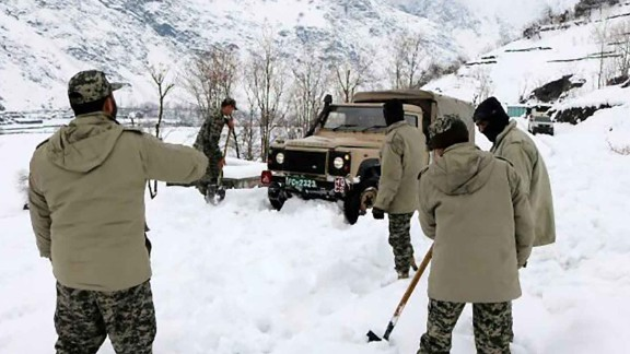 epa05772877 Chitral scouts make effort to reach the avalanche hit areas in Chitral, Pakistan, 05 February 2017. At least 10 people were killed and five wounded when an avalanche hit a village in Chitral. Severe cold weather affected many parts of Pakistan, as snowfall over Balochistan province and hilly resulted in the closure of several roads.  EPA/HAMMAD KHAN FAROOQI BEST QUALITY AVAILABLE