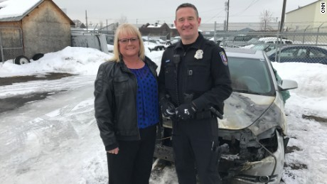 Spokane Police Officer Tim Schwering freed Kim Novak from her burning car in January.