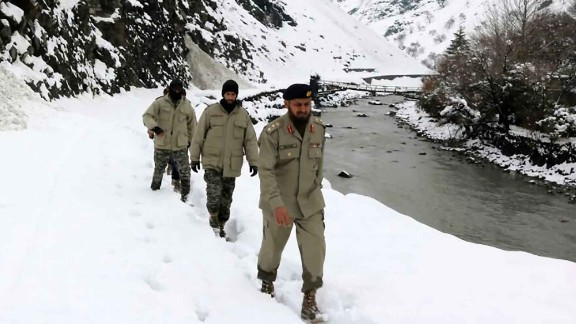 Scouts try to reach the areas in Chitral, Pakistan, affected by the avalanche.