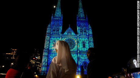 SYDNEY, AUSTRALIA - DECEMBER 12:  A Catholic nun looks on as the 2013 Lights Of Christmas are launched at St Mary's Cathedral on December 12, 2013 in Sydney, Australia. Lights of Christmas is an annual event illuminating the facade of St Mary's Cathedral to celebrate the spirit of Christmas.  (Photo by Lisa Maree Williams/Getty Images)