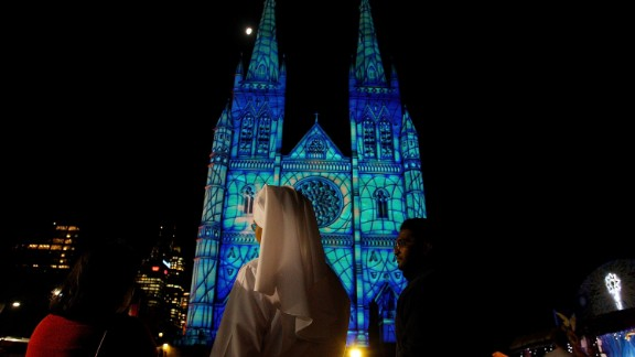 SYDNEY, AUSTRALIA - DECEMBER 12:  A Catholic nun looks on as the 2013 Lights Of Christmas are launched at St Mary