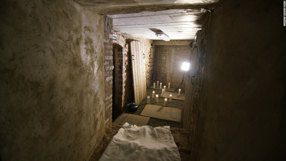 The vault is reached down a narrow flight of steps, through a corridor replete with old pipes at head height, then by scrambling through a hole in a thick foundation wall built in 1846.