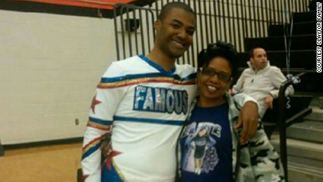 Cedric Claytor, pictured with a family friend, was a high school cheerleader and hoped to be an accountant.
