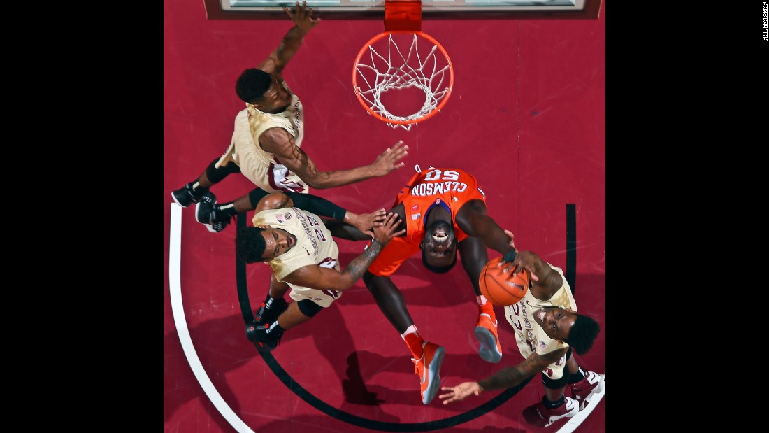 Clemson center Sidy Djitte is surrounded by Florida State players as he tries to pull in a rebound during a college basketball game on Sunday, February 5.