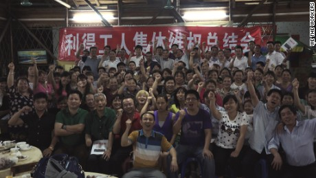 Strikers and Panyu Workers Center activists celebrate in late 2015.