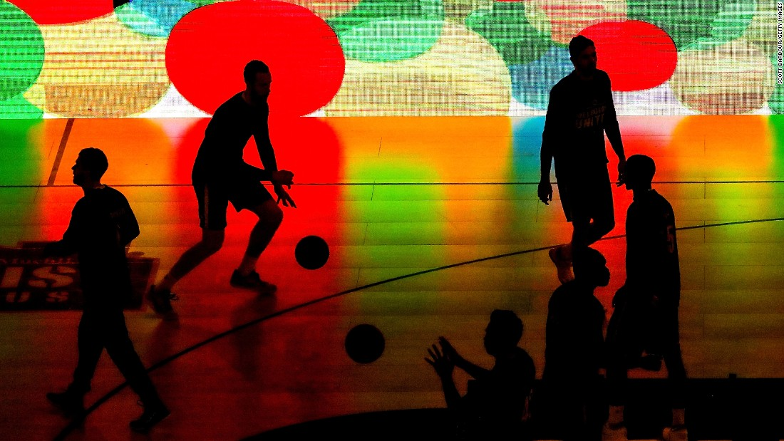 Players from Australia's National Basketball League warm up at a game in Melbourne on Monday, February 6.