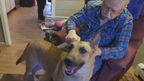 Ken Job pets his service dog, Jeb.