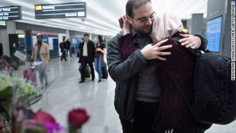 Court hears arguments in travel ban case