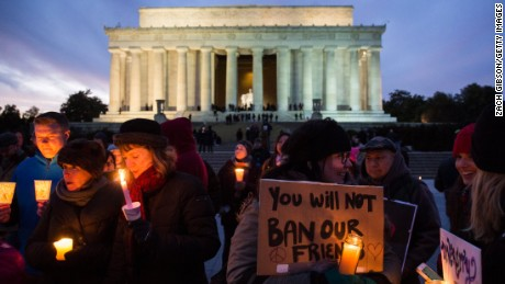 People hold candles during a vigil in front of the Lincoln Memorial on February 4. The vigil was held in solidarity with protests against President Donald Trump's travel ban policy.
