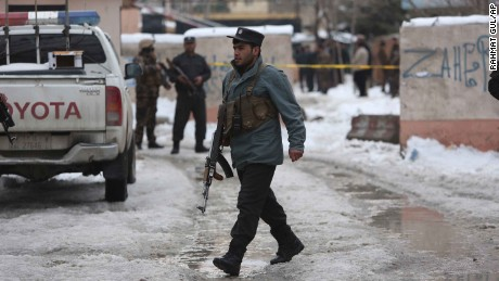 Police inspect the site of the attack Tuesday in Kabul.
